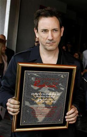 Jimmy Chamberlin, a member of the rock group ''Smashing Pumpkins'', displays his plaque after he and band member Billy Corgan were inducted into the Hollywood Rock Walk in Hollywood April 23, 2008. REUTERS/Fred Prouser