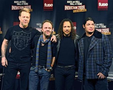 Metallica, the heavy metal band, poses for pictures after the Rock and Roll Hall of Fame announced their 2009 inductees in New York January 14, 2009. Pictured are (L to R) vocalist James Hetfield, drummer Lars Ulrich, guitarist Kirk Hammett and bass player Robert Trujillo. REUTERS/Ray Stubblebine
