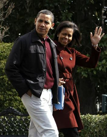 President Barack Obama and first lady Michelle Obama walk toward Marine One as they depart the White House in Washington to spend the weekend at Camp David March 21, 2009. REUTERS/Kevin Lamarque