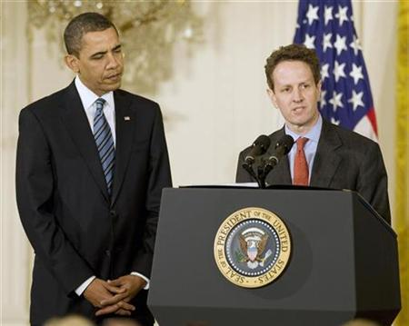 President Barack Obama is joined by U.S. Secretary of Treasury Timothy Geithner (R) while they talk with small business owners, community lenders, and members of Congress in the East Room of the White House in Washington, March 16, 2009. REUTERS/Larry Downing