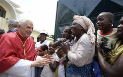 <p>Pope Benedict XVI greets people during his visit in Luanda, March 21, 2009. REUTERS/Osservatore Romano/Pool</p>