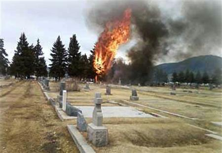 Flames and billowing smoke rise after a single-engine private passenger plane crashed into a cemetery, on approach to an airport in Butte, Montana, killing 17 people, March 22, 2009. REUTERS/Photo courtesy of the Montana Standard/Martha Guidoni/Handout