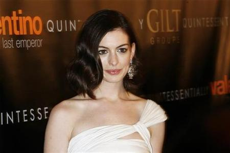Anne Hathaway arrives at the premiere of the film ''Valentino: The Last Emperor'' in New York March 17, 2009. REUTERS/Lucas Jackson