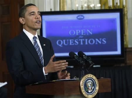 U.S. President Barack Obama participates in an ''Open for Questions'' town hall on the economy in the East Room at the White House in Washington March 26, 2009. REUTERS/Jim Young