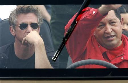 Venezuelan President Hugo Chavez drives his vehicle as actor Sean Penn sits in the back in the western state of Tachira, August 3, 2007. REUTERS/Jorge Silva