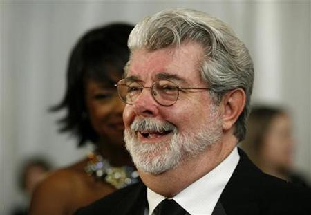 Filmmaker George Lucas speaks to reporters as he arrives for the Ford's Theater Grand Reopening Celebration in Washington February 11, 2009. REUTERS/Molly Riley