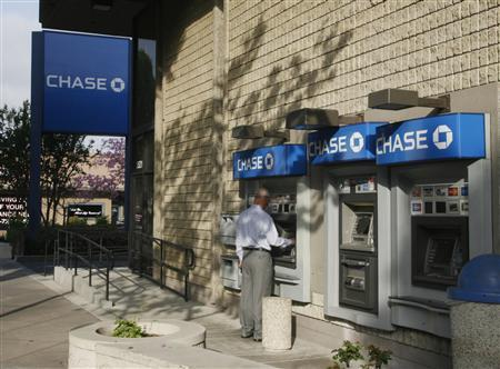 A man uses an ATM machine at a Chase bank, which was formerly a Washington Mutual branch office in Burbank, March 30, 2009. REUTERS/Fred Prouser