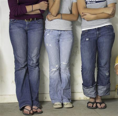 Teen girls are seen in a file photo. REUTERS/Jessica Rinaldi