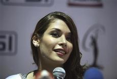 """<p>Après une visite ce mois-ci à Guantanamo Bay, la Vénézuélienne Dayana Mendoza, Miss Univers 2008, a qualifié de """"lieu apaisant, calme et superbe"""" la base où les Etats-Unis ont regroupé quelque 240 prisonniers à l'intérieur d'un rétention qui a fait l'objet de condamnations en divers points du monde. /Photo prise le 21 janvier 2009/REUTERS/Oswaldo Rivas</p>"""