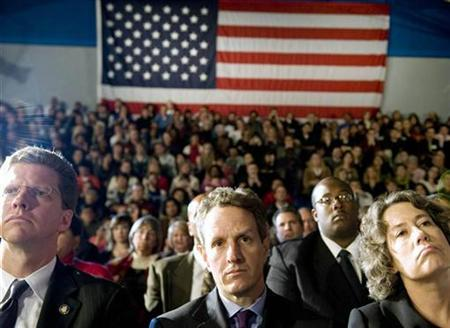 Secretary of the Treasury Timothy Geithner listens to President Obama speak in Mesa, Arizona, February 18, 2009. REUTERS/Larry Downing
