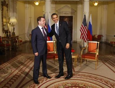 President Barack Obama meets Russian President Dmitry Medvedev at Winfield House, the U.S. ambassador's residence in London April 1, 2009. REUTERS/Jason Reed