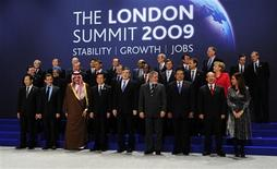 <p>Heads of delegation pose for the official group photograph at the G20 summit at the ExCel centre, in east London April 2, 2009. (L-R) Back row: Dominique Strauss-Kahn, Managing Director of the International Monetary Fund (IMF), Ban Ki-moon, U.N. Secretary-General, Pascal Lamy, Director General of the World Trade Organisation, Abhisit Vejjajiva, Prime Minister of Thailand, Silvio Berlusconi, Prime Minister of Italy, Meles Zenawi, Prime Minister of Ethiopia, Kevin Rudd, Prime Minister of Australia, Taro Aso, Prime Minister of Japan, Mirek Topolanek, Prime Minister of the Czech Republic, Mario Draghi, Chairman of the Financial Stability Forum, Robert Zoellick, World Bank President. Middle Row: Jose Manuel Barroso, President of the European Commission, Manmohan Singh, Prime Minister of India, Tayyip Erdogan, Prime Minister of Turkey, Barack Obama, U.S. President, Dmitry Medvedev, President of Russia, Kgalema Motlanthe, President of South Africa, Jan Peter Balkenende, Prime Minister of the Netherlands, Jose Luis Rodriguez Zapatero, Prime Minister of Spain, Angela Merkel, Chancellor of Germany. Front Row: Lee Myung-bak, President of South Korea, Nicolas Sarkozy, President of France, Prince Saud al-Faisal, Foreign Minister of Saudi Arabia, Hu Jintao, President of China, Gordon Brown, Prime Minister of Britain, Luiz Inacio Lula Da Silva, President of Brazil, Susilo Bambang Yudhoyono, President of Indonesia, Felipe Calderon, President of Mexico, Cristina Fernandez de Kirchner, President of Argentina. REUTERS/Dylan Martinez (BRITAIN BUSINESS POLITICS)</p>