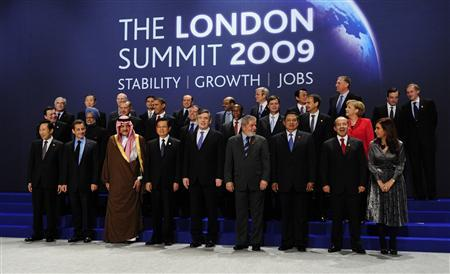 Heads of delegation pose for the official group photograph at the G20 summit at the ExCel centre, in east London April 2, 2009. (L-R) Back row: Dominique Strauss-Kahn, Managing Director of the International Monetary Fund (IMF), Ban Ki-moon, U.N. Secretary-General, Pascal Lamy, Director General of the World Trade Organisation, Abhisit Vejjajiva, Prime Minister of Thailand, Silvio Berlusconi, Prime Minister of Italy, Meles Zenawi, Prime Minister of Ethiopia, Kevin Rudd, Prime Minister of Australia, Taro Aso, Prime Minister of Japan, Mirek Topolanek, Prime Minister of the Czech Republic, Mario Draghi, Chairman of the Financial Stability Forum, Robert Zoellick, World Bank President. Middle Row: Jose Manuel Barroso, President of the European Commission, Manmohan Singh, Prime Minister of India, Tayyip Erdogan, Prime Minister of Turkey, Barack Obama, U.S. President, Dmitry Medvedev, President of Russia, Kgalema Motlanthe, President of South Africa, Jan Peter Balkenende, Prime Minister of the Netherlands, Jose Luis Rodriguez Zapatero, Prime Minister of Spain, Angela Merkel, Chancellor of Germany. Front Row: Lee Myung-bak, President of South Korea, Nicolas Sarkozy, President of France, Prince Saud al-Faisal, Foreign Minister of Saudi Arabia, Hu Jintao, President of China, Gordon Brown, Prime Minister of Britain, Luiz Inacio Lula Da Silva, President of Brazil, Susilo Bambang Yudhoyono, President of Indonesia, Felipe Calderon, President of Mexico, Cristina Fernandez de Kirchner, President of Argentina. REUTERS/Dylan Martinez (BRITAIN BUSINESS POLITICS)