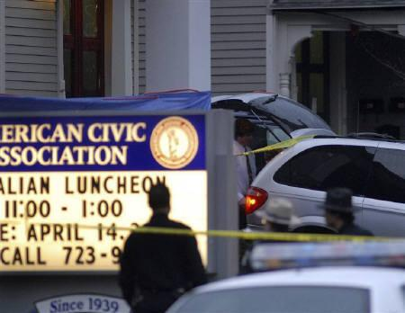 Victims are removed from a shooting scene onto awaiting hearse at the American Civic Center on Front Street in Binghampton, New York April 3, 2009. REUTERS/Hans Pennink