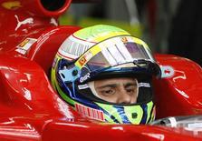 <p>Piloto brasileiro da Ferrari Felipe Massa no Grande Prêmio da Malásia. 04/04/2009. REUTERS/David Loh</p>