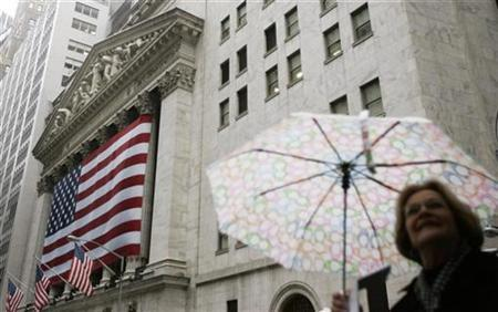 A woman walks past the New York Stock Exchange in New York in this March 11, 2009 file photo. REUTERS/Lucas Jackson