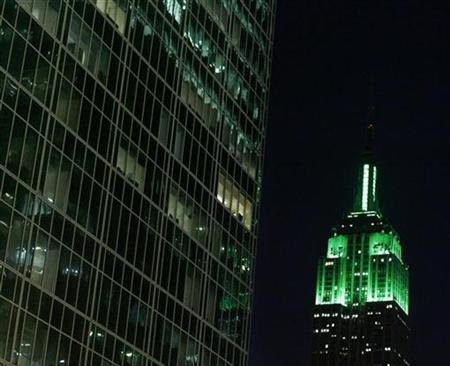 The Empire State Building is lit with green lights during St. Patrick's Day in New York March 17, 2009. REUTERS/Lucas Jackson
