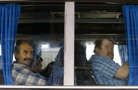 Moldovan citizens wait in a bus to pass the border between Romania and Moldova in Albita, 360 km northeast of Bucharest, April 8, 2009. REUTERS/Bogdan Cristel