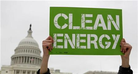 A demonstrator for clean energy holds up a sign during a rally on Capitol Hill in Washington March 2, 2009. REUTERS/Kevin Lamarque