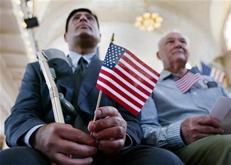 A swearing-in ceremony for new citizens on Ellis Island in a file photo. REUTERS/Shannon Stapleton