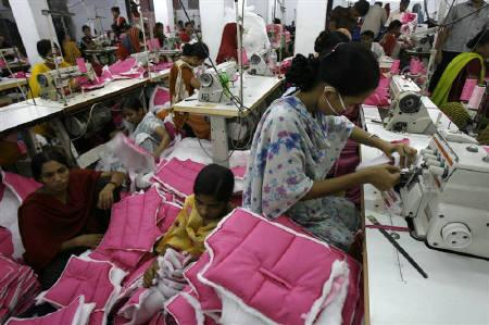 File photo of employees working at a garment factory in Dhaka July 8, 2008. REUTERS/Andrew Biraj/Files