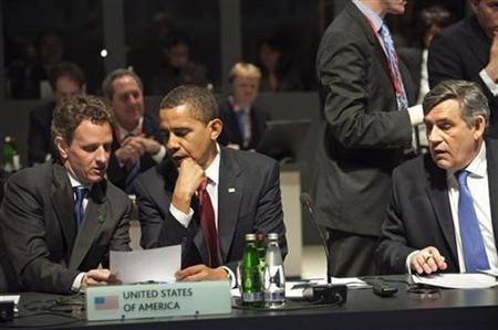 U.S. President Barack Obama (C), Secretary of the Treasury Timothy Geithner (L) and British Prime Minister Gordon Brown attend the plenary session at the G20 summit at the ExCel centre, in east London April 2, 2009. EUTERS/Philippe Wojazer