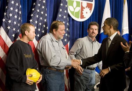 President Obama shakes hands with construction workers after speaking about the economy at the Department of Transportation in Washington, April 13, 2009. REUTERS/Larry Downing
