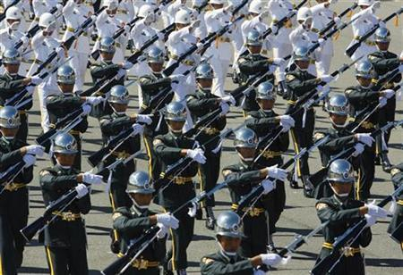 Military honour guards perform during the Taiwan's National Day celebrations in front of the Presidential Office in Taipei October 10, 2008. REUTERS/Nicky Loh