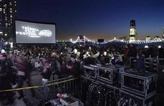 <p>Moviegoers wait for it to get dark before the outdoor screening of films from Tropfest, at the Tribeca Film Festival in New York April 28, 2006. REUTERS/Chip East BEST QUALITY AVAILABLE</p>