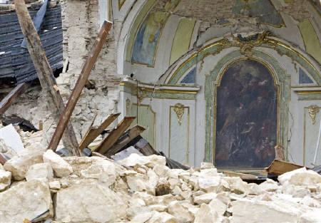 The painted chapel of a destroyed church is seen in Saint Gregorio, near Aquila April 13, 2009. Formula One drivers united on Saturday in support of charity efforts to help tens of thousands of people made homeless by this month's earthquake in Italy. REUTERS/Max Rossi