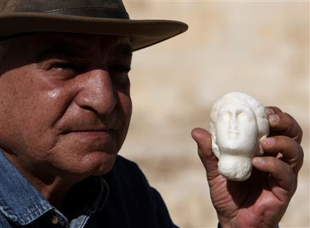 The head of Egypt's Council of Antiquities, Dr. Zahi Hawas holds an alabaster statue of Queen Cleopatra as he posses to photographers, in the Temple of Taposiris Magna some 50 km west of Alexandria April 19, 2009. Archaeologists think they may be close to locating the graves of the doomed lovers Cleopatra and Mark Antony in the Temple of Taposiris Magna west of Alexandria. REUTERS/Goran Tomasevic