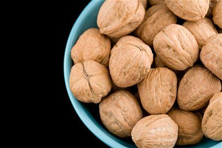 Walnuts in a bowl are seen in this undated handout photo. (REUTERS/Newscom)