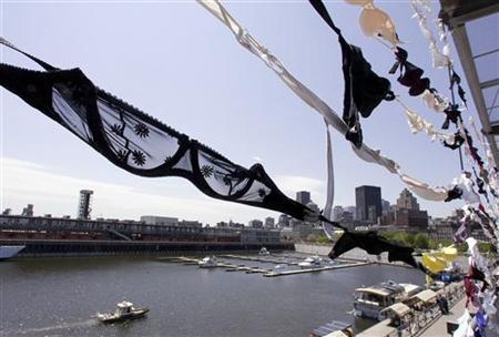 Thousands of bras hang in the Old Port of Montreal May 29, 2008. REUTERS/Christinne Muschi