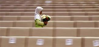 <p>A Malaysian Muslim girl walks through an aisle at the end of a ceremony on the first day of Moharram, which marks the start the Muslim new year, in Putrajaya January 10, 2008. REUTERS/Bazuki Muhammad</p>