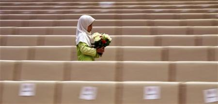 A Malaysian Muslim girl walks through an aisle at the end of a ceremony on the first day of Moharram, which marks the start the Muslim new year, in Putrajaya January 10, 2008. REUTERS/Bazuki Muhammad