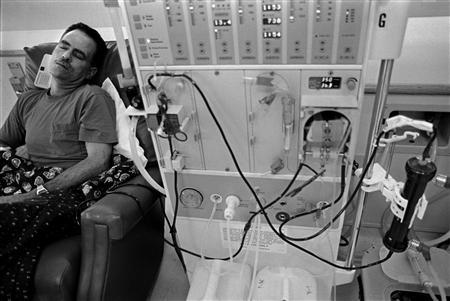 A patient takes a nap while undergoing kidney dialysis treatment in this undated handout photo. REUTERS/Newscom/Handout
