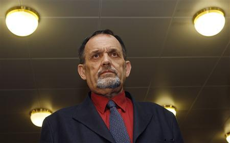 Austrian Holocaust denier Gerd Honsik arrives in court on the third day of his trial in Vienna April 27, 2009. REUTERS/Heinz-Peter Bader