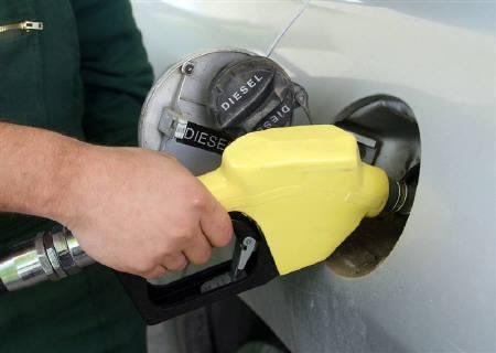 An employee fills a car with fuel at a petrol station in Tirana in this July 2008 file photo. World oil demand is forecast to fall this year by much more than previously expected, as growth stalls in emerging powerhouses China and India and fuel consumption declines in the developed world. REUTERS/Arben Celi