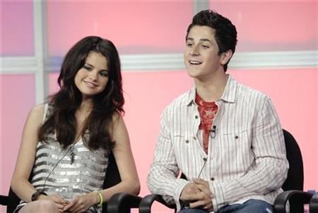 Selena Gomez (L) and David Henrie answer questions during the panel for the Disney Channel series ''Wizards of Waverly Place'' at the Television Critics Association Summer Press Tour in Beverly Hills, California July 14, 2007. REUTERS/Phil McCarten