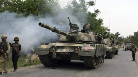 Pakistani army tanks patrol in the Buner district, where troops launched an offensive against militants, May 3, 2009. REUTERS/Stringer