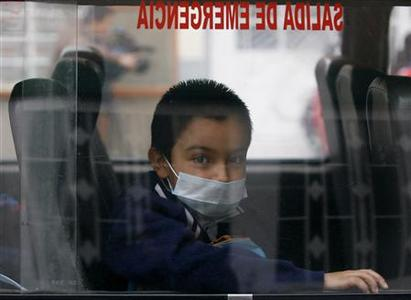 A boy wears a mask inside a bus in Bogota May 4, 2009. REUTERS/John Vizcaino