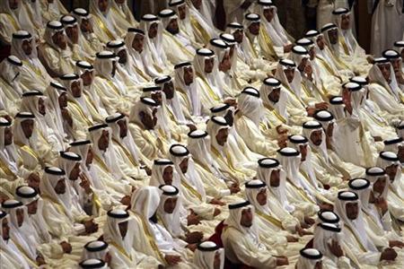 Grooms take part in a mass wedding ceremony in Riyadh June 24, 2008. REUTERS/Ali Jarekji