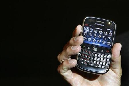 Jim Balsillie, co-chief executive of Research In Motion (RIM), holds a Blackberry Bold handset in Mumbai September 18, 2008. REUTERS/Punit