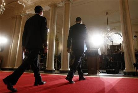 President Barack Obama (front) and Treasury Secretary Tim Geithner walk toward the rostrum to speak about tax reform at the White House in Washington May 4, 2009. REUTERS/Kevin Lamarque