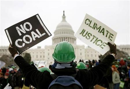 Demonstrators for clean energy hold a rally on Capitol Hill in Washington March 2, 2009. REUTERS/Kevin Lamarque