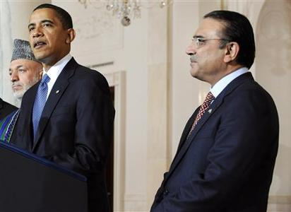 Pakistan's President Asif Ali Zardari (R) listens to a statement to reporters by President Barack Obama with Afghanistan's President Hamid Karzai at the White House, May 6, 2009. REUTERS/Jonathan Ernst