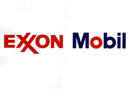 The Exxon corporate logo and the Mobil corporate logo were displayed side by side at a news conference in New York in this December 1 file photo. REUTERS/HO Old