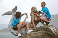 """<p>""""The Best Job in the World"""" competition finalists George Karellas (L) of Ireland and Ben Southall of Britain sit on a mermaid statue during a media opportunity on Daydream Island, about 950km (590 miles) north of Brisbane, May 5, 2009. Karellas and Southall are two of 16 finalists from 15 nations in the tourism promotion competition aimed at attracting visitors to Australia's northeast tropical state of Queensland. The winner will earn A$150,000 ($110,000) in the role of """"Island Caretaker"""" on the Great Barrier Reef for six months. REUTERS/Tourism Queensland/Eddie Safarik/Handout</p>"""