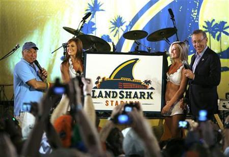 Owner and managing general partner of the Miami Dolphins NFL team Stephen M. Ross (R) and singer Jimmy Buffett (L) attend the renaming event of the Dolphins stadium in Miami, Florida May 8, 2009. The Dolphins Stadium will be renamed LandShark Stadium. REUTERS/Carlos Barria