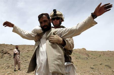 A U.S Marine searches an Afghan man for weapons in the Golestan district of Farah province May 8, 2009. REUTERS/Goran Tomasevic